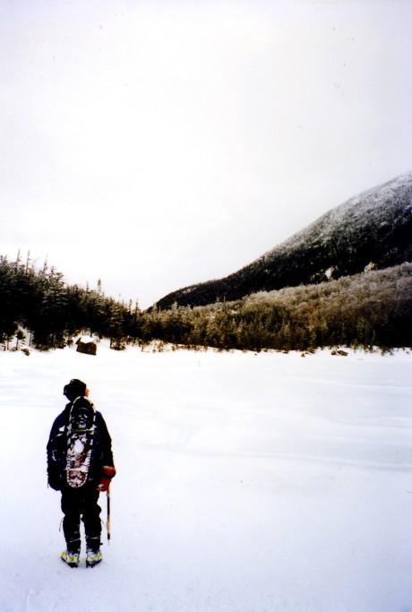 Bob crosses Lonesome Lake on the way to North Kinsman.