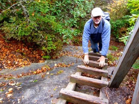 Gary descends a ladder.