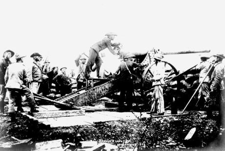 """Boers with """"Long Tom"""" siege gun at Mafeking."""
