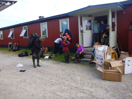 Members of the group organize gear at Ritsem.