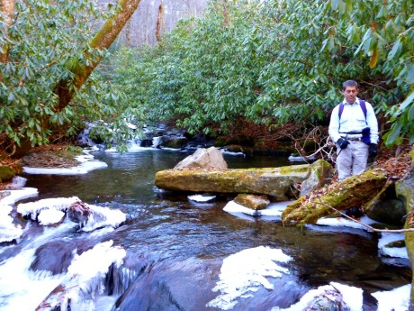 Ken beside the stream.