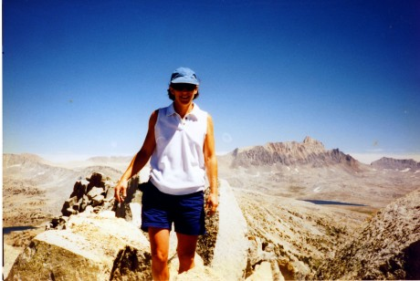 Helen on the summit ridge. Mt. Humphreys in the background.